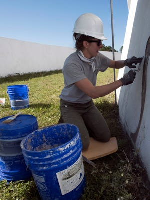 Elizabeth Price, a National Parks Service preservationist, works on renovations to the exterior of Battery San Antonio at Pensacola Naval Air Station Wednesday, April 11, 2018