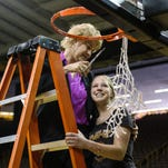 Iowa head coach Lisa Bluder is joined by daughter Emma to cut down the nets to celebrate going 18-0 at home over the course of the season following an 88-70 victory over Miami in the second round of the NCAA women's basketball tournament on Sunday at Carver-Hawkeye Arena.