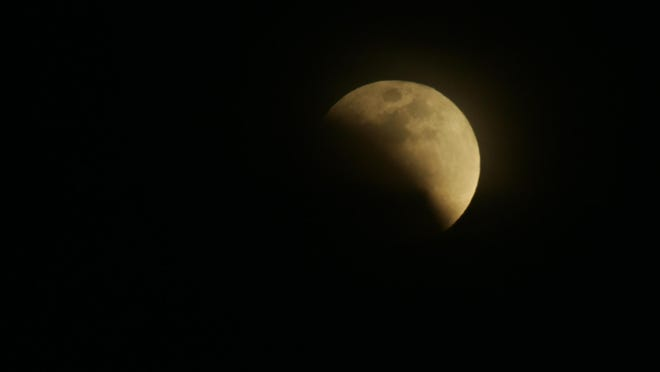 FILE: The moon begins to enter the Earth's shadow at the beginning of a lunar eclipse in 2008.