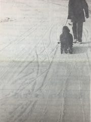 Bill McElroy and his two children, Kevin and Kirk, made the most of the snow during the week of January 2nd, 1991.