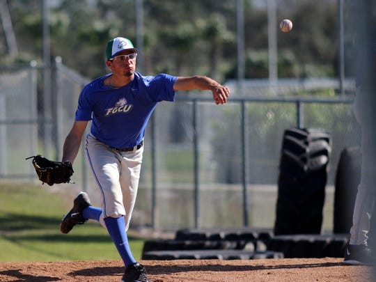 FGCU freshman Devin Smeltzer pitches in the bullpen during an FGCU baseball practice on Tuesday afternoon.