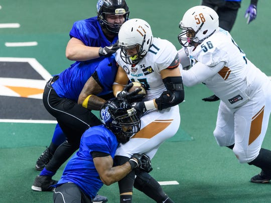 Arizona Rattlers' Jon Wolf  (17) is sacked late in the fourth quarter on Sunday, June 11, 2017 at Taking Stick Resort Arena in Phoenix, Ariz.
