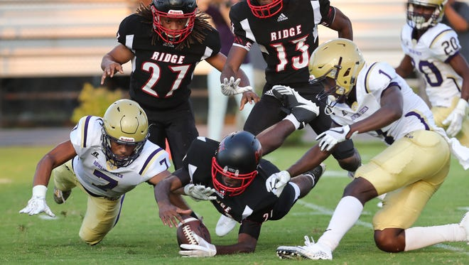 PRP's Tarik Lee (21) recovers a fumble after his teammate Ira Porter (27) forced Bowling Green's Vito Tisdale (7) to cough up the ball during their game at PRP.Aug. 25, 2017