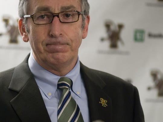 Bob Corran, shown here announcing the termination of both the baseball and softball programs as a cost-cutting measure in 2009, completed a 13-year tenure as UVM athletic director on Thursday.