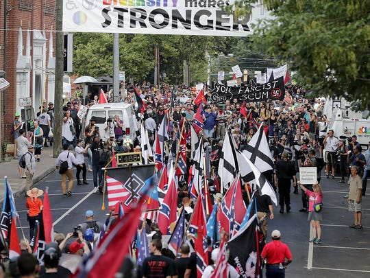 "Hundreds of white nationalists and neo-Nazis marched down East Market Street toward Emancipation Park during the ""Unite the Right"" rally Aug. 12, 2017, in Charlottesville, Va."