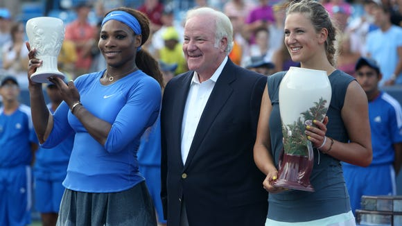 Western & Southern CEO John Barrett stands with Serena Williams and Victoria Azarenka in August of 2013.