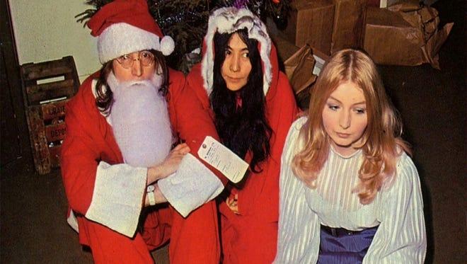 John Lennon, Yoko Ono and Mary Hopkins at the 1968 Apple Xmas party.