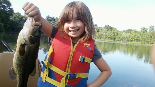 Gabriella Hardin, who caught a 14-inch whopper while fishing with her pop pop.