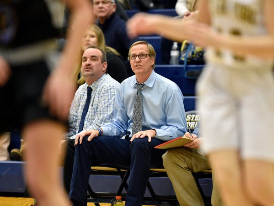 Kennard-Dale head basketball coach Bob Rudisill monitors