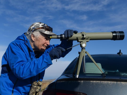 Zona Lindemann of Missoula watches snow geese and other migrating water fowl at Freezout Lake on Wednesday morning.
