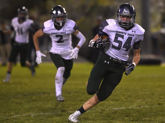 Damonte Ranch's Ryan Madole (54) returns an interception for a touchdown while taking on Spanish Springs during their football game at Spanish Springs on Sept. 15.