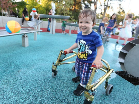 Grayson Aparicio, 3, explores the Let's ALL Play Place during the grand opening on Thursday, Sept. 15, 2016, in Salem. The therapy and community play area, which features wheelchair-friendly areas, is located at the corner of Mission Street SE and Church Street SE on the Salem Health campus.