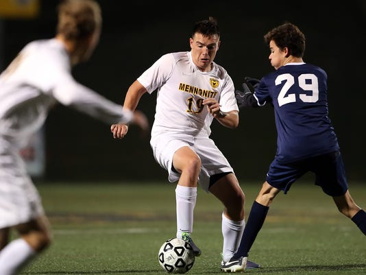 Lancaster Mennonite's Chase Ross (10) keeps the ball away from Wyomissing's Maxwell Moyer (29) during first half action at Lancaster Mennonite High School Monday October 26, 2015. Chris Knight - GametimePa.com
