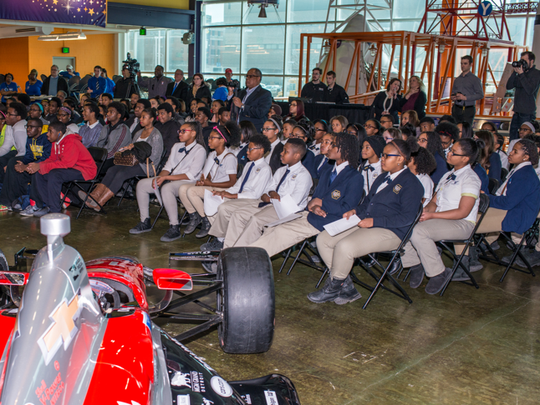 Students from Martin Luther King High School and University Prep Middle School in Detroit attend a Grand Prix press conference with Comerica Bank in February at the Michigan Science Center.