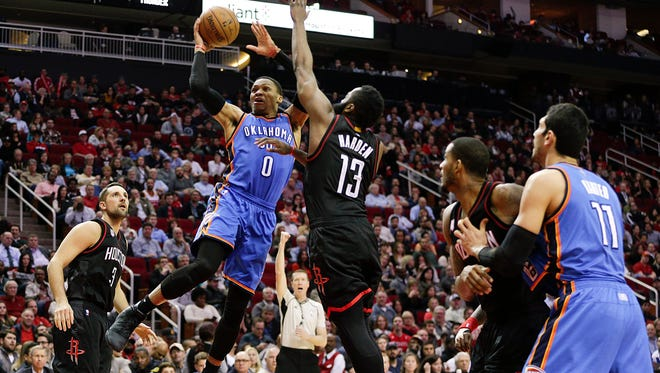 Oklahoma City Thunder guard Russell Westbrook (0) drives against Houston Rockets guard James Harden (13) in the second half at Toyota Center. Houston Rockets won 118 to 116.