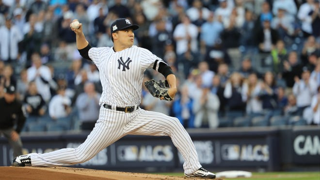 Masahiro Tanaka pitches for the Yankees during the first inning of Game 5, Wednesday, October 18, 2017.