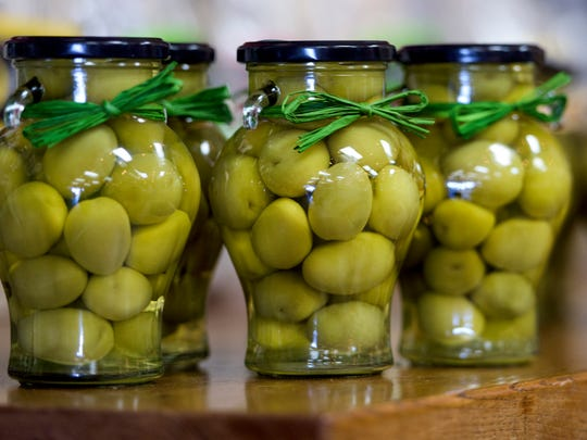 Olives are shown at the Vintage Olive in Montgomery,