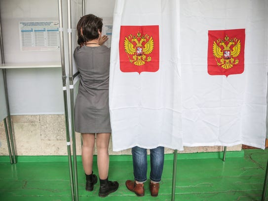 Members of a local election commission prepare a polling