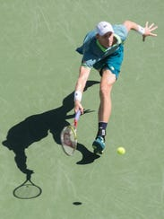 South African Kevin Anderson plays  against Borna Coric