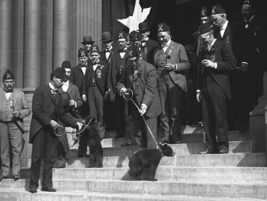 Shriners pose with bear cubs on the steps of the Masonic