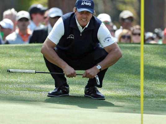 Phil Mickelson lines up his putt on six during the second round of the Masters golf tournament at Augusta National Golf Club in Augusta, Ga., Friday, April 6, 2018. (Jason Getz/Atlanta Journal-Constitution via AP)