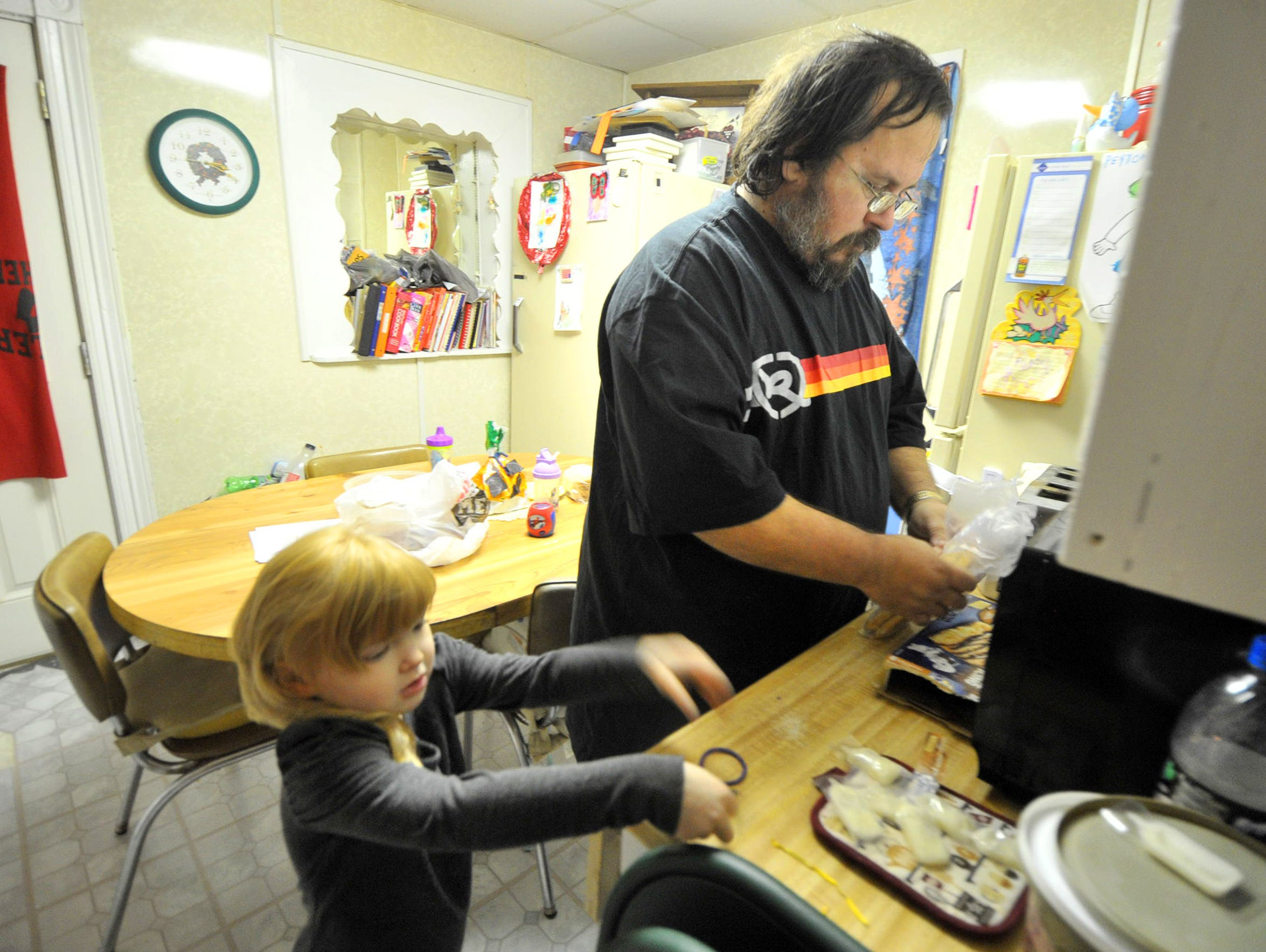 Clint Worden and his daughter Peyton make some snacks