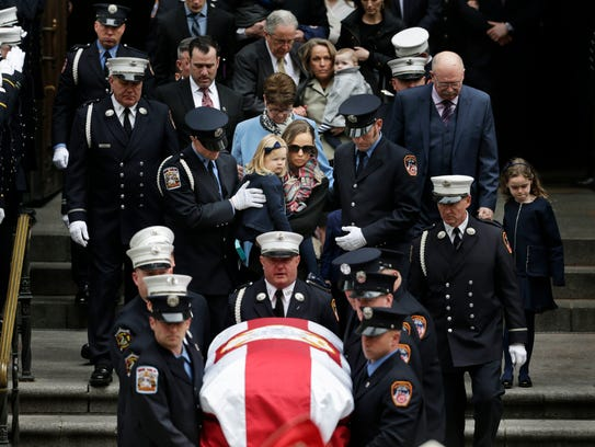 The family of firefighter Michael Davidson, including