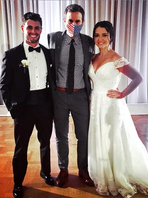 Guy Benson, center, with Dylan and Alyson Doucette at their wedding in Boston.