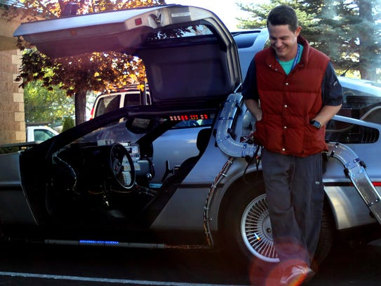 Jeff Gladding, 34, stands next to his DeLorean on Wednesday