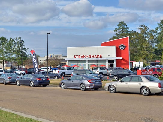 Dozens of customers line the streets to get into the new Steak 'n Shake now open at 300 Riverwind Dr. in Pearl.