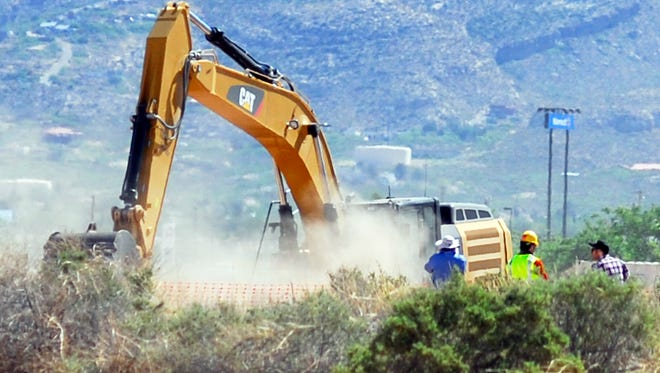 """Crews begin digging at the old Alamogordo, N.M., landfill on Fridayto search for copies of the Atari game """"E.T. The Extraterrestrial"""" purportedly buried there in the 1980s.  The game is considered among gamers to be one of the worst ever and is believed to have contributed to the demise of Atari. (AP Photo/Alamogordo Daily News, John Bear)"""