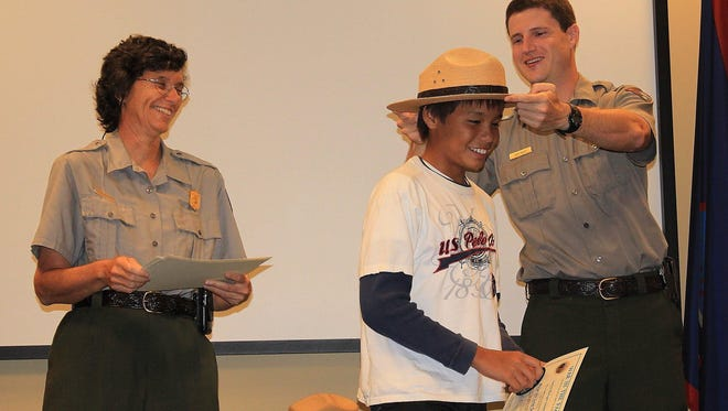 In this 2011 file photo, Ricardo Jose Samonte tries on the Park Ranger hat.