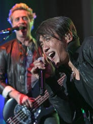 Arnel Pineda and Journey perform at the 2012 Iowa State Fair.