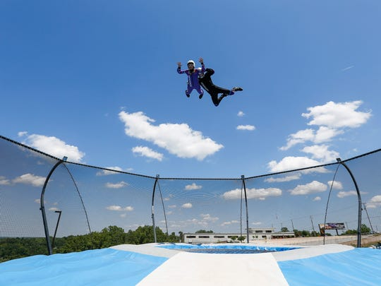 Twelve-year-old Takoda Slavens from Oklahoma is helped aloft by flight instructor Edgars Strads as he takes a flight on the Aerodium at Fritz's Adventure on Tuesday, June 5, 2018. The Aerodium is an outdoor skydiving simulator that uses a giant fan to send people aloft on a cushion of air.