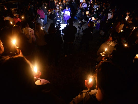 People come together during the 'Break the Silence Against Domestic Violence' candle light vigil.