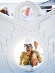 Delayne Corbet from Vancouver, Canada, works on an intricate wing sculpture during the master sculptors doubles competition on Sunday, Nov. 27, 2016, at the 30th Annual American Sand Sculpting Championship in Fort Myers Beach, Fla. The 10-day event ended Sunday with the advanced amateur national and master sculptors doubles competitions.