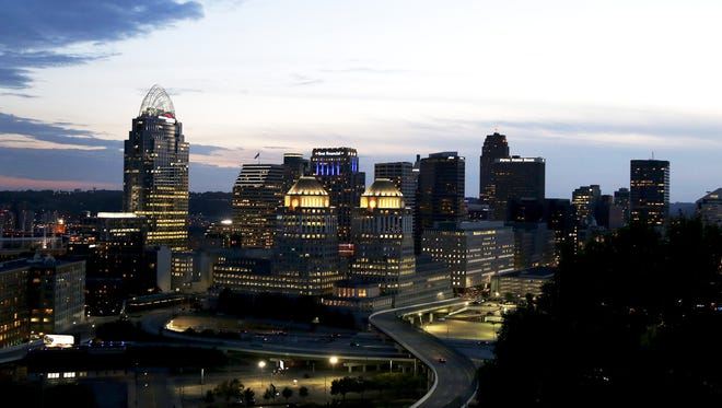 The sun sets over the Cincinnati skyline, seen from Mount Adams, Wednesday, Oct. 5, 2017. Pictured is the Great American Tower at Queen City Square, left, and P&G headquarters.
