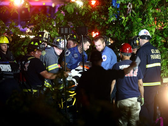 Victims are rescued after being entrapped in a car on Ford Avenue in Morristown after a heavy storm brought down a large tree on top of the vehicle. June 18, 2018. Morristown, NJ