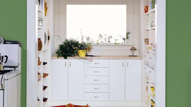 """The new """"super pantry"""" like the Retro Pantry by California Closets features shelving, cabinetry and counter space for food prep."""