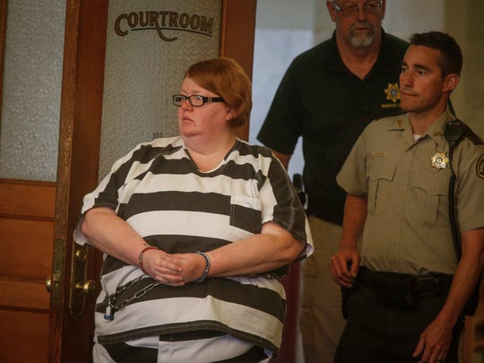 Misty Ray is brought into the Dallas County Courthouse in Adel for her bond hearing on Wednesday, May 25, 2017. Ray and her husband, Marc, are being charged in connection in the death of their adoptive daughter, Sabrina, who was found dead in their Perry home.