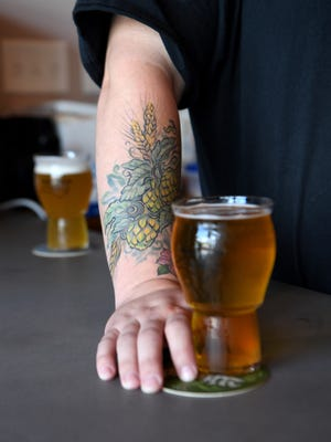 Josh Austin, Fermented Nonsense Brewery brewer, has a tattoo of hops, illustrating his love of beer, on his arm.