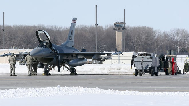 One of the 176th Fighter Squadron's F-16Cs is prepared to take off on a training mission at the Wisconsin Air National Guard 115th Fighter Wing based at Truax Field in Madison. Due to inclement weather, F-16 Fighting Falcons landed at General Mitchell International Airport in recent days.
