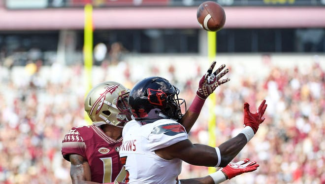Louisville Cardinals wide receiver Seth Dawkins (5) catches a touchdown past Florida State defensive back Kyle Meyers (14) in the second half at Doak Campbell Stadium in the 2017 game between the teams. Mandatory Credit: Melina Vastola-USA TODAY Sports