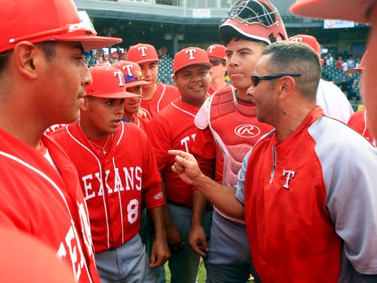 Ray's head coach Orlando Ruiz talks to his players