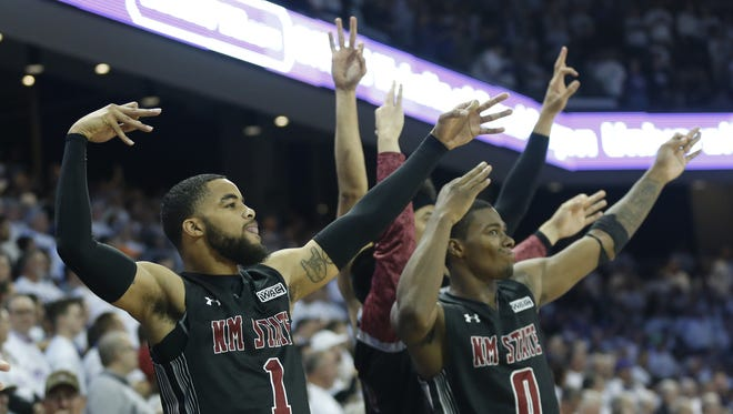 New Mexico State's Shunn Buchanan (1) and teammates celebrate a basket against GCU during the first half at GCU Arena on January 11, 2018 in Phoenix, Ariz.