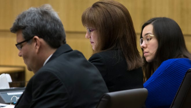 Defense attorneys Kirk Nurmi (left) and Jennifer Willmott (center) and Jodi Arias listen during the sentencing phase of her retrial at Maricopa County Superior Court in Phoenix on Jan. 28, 2015.