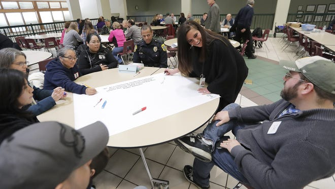 Facilitator Jennifer Sipes leads her discussion table of parents and concerned citizens in brainstorming ideas to keep schools safe at the Green Bay Area Public School's school safety forum Saturday at Preble High School in Green Bay.
