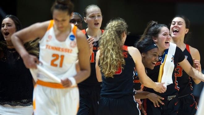 Oregon State players celebrate their 66-59 win over Tennessee in the second round of the NCAA tournament.