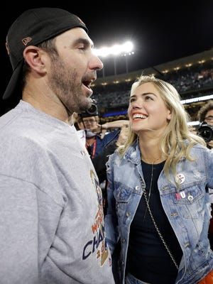 Houston Astros' Justin Verlander celebrates with fiancee Kate Upton after the Astros beat the Los Angeles Dodgers in Game 7 of the World Series Wednesday. The couple will get married in Italy this weekend.