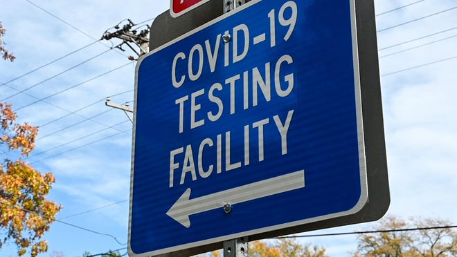 A sign at Guilford Road and Parkview Avenue in Rockford points toward a COVID-19 testing facility at the University of Illinois College of Medicine Rockford.